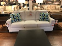 white 3-seat sofa and loveseat with throw pillows