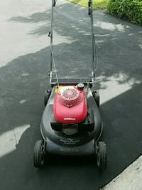 red and black Honda push mower Sunrise, 33351