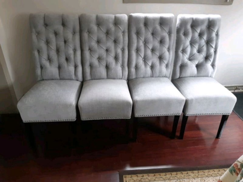 Brand new set of 4 high back tufted dining chairs  53473cbc-bf79-43bd-a01a-b9cc7db88946