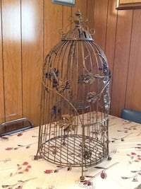 Brown metal decorative birdcage. Approximately 31 inches tall.  Toronto, M1L