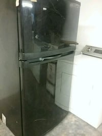 black fridge. Scratch, barely noticable Spartanburg