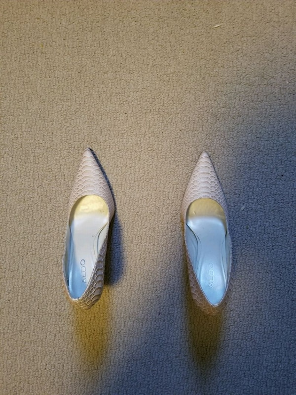 pair of white leather pointed toe heeled shoes 1