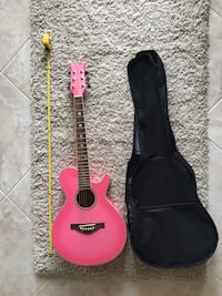 Guitar - pink daisy rock, includes bag