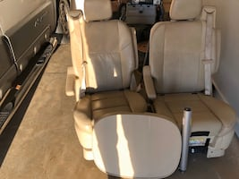 2008 Chrysler town and country center captain chairs with table.