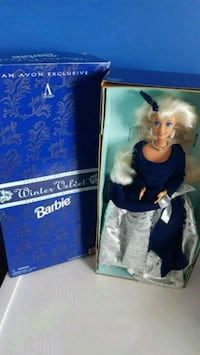 two Barbie dolls in boxes Calgary, T2Z 3Y5