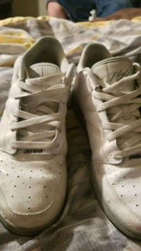 pair of white Nike low-top sneakers 381 mi