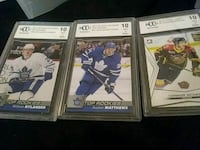 three assorted ice hockey trading cards Edmonton, T5P 2H4