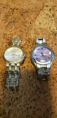 two round silver analog watches with link bracelets 40 km