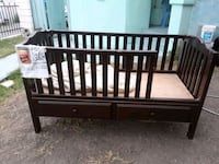 baby's brown wooden crib Los Angeles, 90011