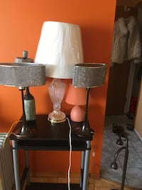 Two brown and black table lamps