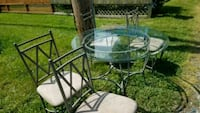 round glass top table with four chairs dining set Newark, 19702