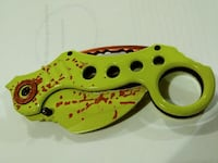 green and red pocket knife Cookeville, 38506