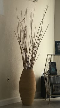 artificial twigs and brown floor vase