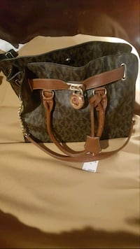 brown and beige Michael Kors leather 2-way bag 539 km
