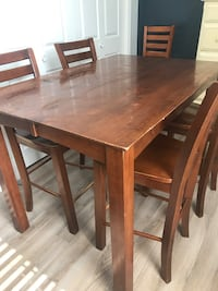 """Tall wooden table - 34.5""""h by 54""""l by 36""""w.  With leaf table is 54"""" square.  Comes with 5 chairs. Chicago, 60608"""