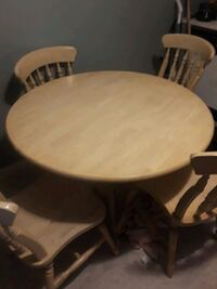 round brown wooden table with four chairs  Quincy, 02169
