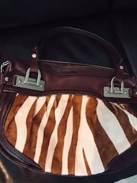 Heavy leather purse with horse hide front . From B . Makowsky