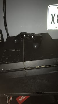 black Sony PS4 console with controller Houston, 77088