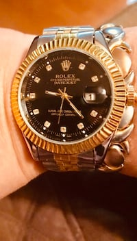 Round gold-colored rolex analog watch with link bracelet Laval, H7X 1B9