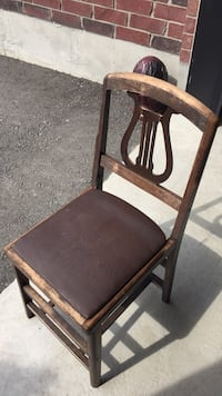 brown wooden framed black leather padded armchair Innisfil, L0L