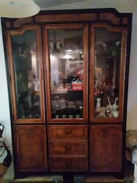 brown wooden frame glass display cabinet