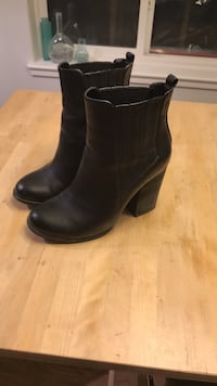 pair of black leather booties Calgary, T2S 0G9