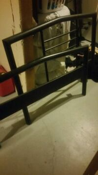 Single bed frame with mattress and slats
