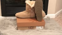 unpaired brown UGG boots on box