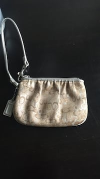 Monogrammed brown coach leather wristlet