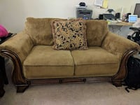 Latte colored cloth love seat 184 mi