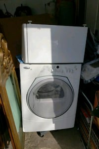 white front load dryer with the storage box
