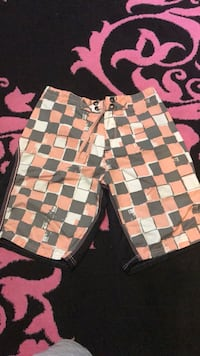 Pink white and black Oakley board shorts  Reading, 19606