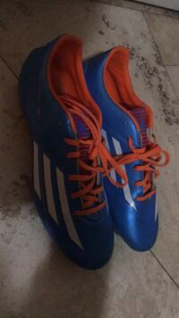 pair of blue-and-orange Adidas cleats Vaughan, L4H 3C2