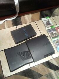 black Sony PS3 slim console with game cases