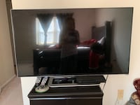 black flat screen TV and brown wooden TV stand Springfield, 22153