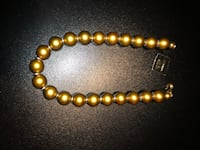 Cosmetic jewelry gold beaded necklace  New York, 10465