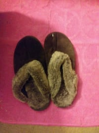 pair of brown home slippers