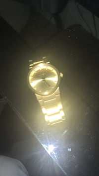 Gold plated nixon watch. Bought for $150. Small scratches on wristband.