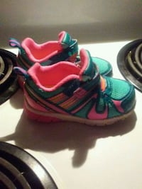 pair of green-and-red Nike running shoes Anderson, 96007