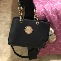 black Michel Kors leather tote bag
