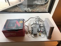 black Nintendo Wii console with controllers and game cases Toronto, M5B 2A9