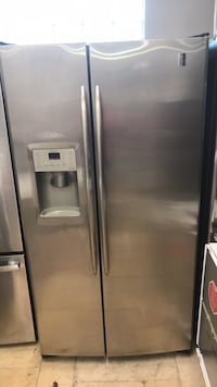 stainless steel side-by-side refrigerator with dispenser West Palm Beach, 33409