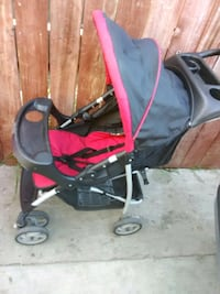 baby's black and red stroller Los Angeles, 90061