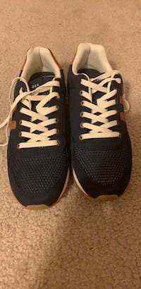 pair of black-and-white Nike running shoes 232 mi