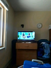 black flat screen TV with white wooden TV stand Boulder, 80303