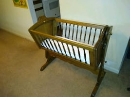 Wooden rocking bassinet