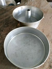 two stainless steel cooking pots 547 km