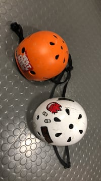 Two white and orange bicycle helmets Milton, L9T 5V5