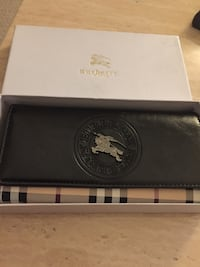 White and black burberry leather wallet Calgary, T2Z 4S9
