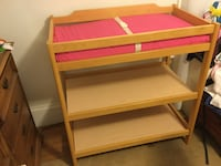Light wood baby changing table with pad and safety buckle. Waltham, 02453